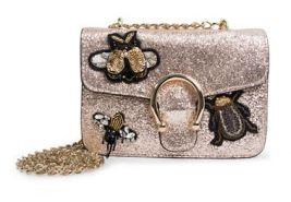 http://www.thebay.com/webapp/wcs/stores/servlet/en/thebay/handbags/crossbodybags/syra-embellished-crossbody-bag-0600089822723--24